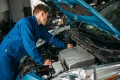 Mechanic repairs car engine, motor diagnostic poster