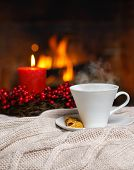 Cup Of Hot Drink With Steam And Cookie Berries Red Candle In Christmas Decoration On Cozy Knitted Pl poster