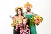 Parents And Daughter Farmers Celebrate Harvest Holiday. Harvest Festival Concept. Family Rustic Styl poster
