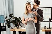 Young Lawyers Flirting During Work Day In Office, Office Romance Concept poster