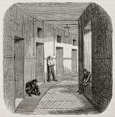 Antique illustration of corridor of confinement rooms at psychiatric hospital Saint Anne, Paris. Cre