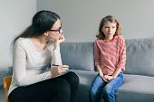 Professional Child Psychologist Talking With Child Girl In Office. poster