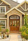 stock photo of brownstone  - Entrance of a nice house with outdoor landscape - JPG