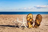 Flip Flops And Starfish On Sand Beach. Summer Vacation On Baltic Sea, Germany Concept poster