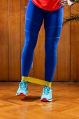 Woman Exercising With Elastic Band poster