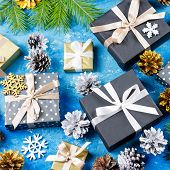 Blue Christmas Background With Fir Branches, Black Giftboxes, Silver And Golden Decorations poster