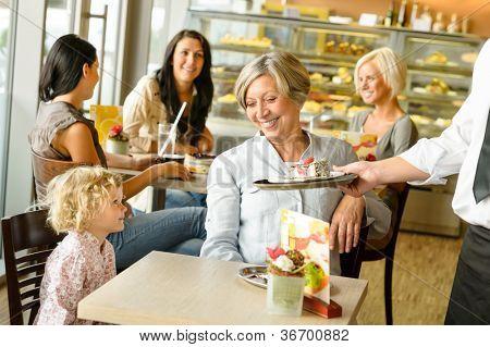 Grandmother and grandchild waiting cake order cafe dessert waiter plate