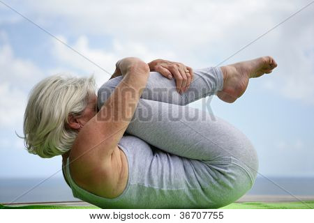 Woman holding a yoga position
