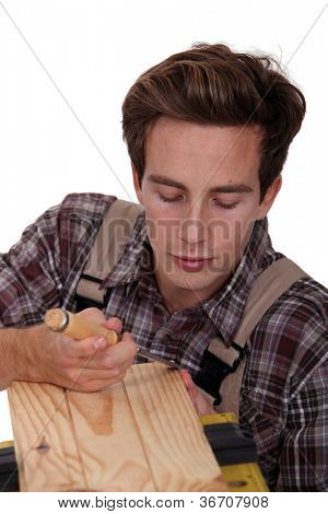 Carpenter using a chisel to sculpt wood