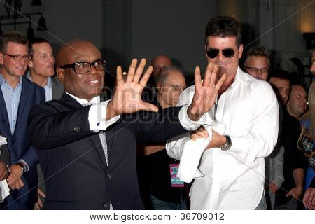 LOS ANGELES - SEP 11:  LA Reid, Simon Cowell at the FOX  X-Factor Judges Handprint Ceremony at Graumans Chinese Theater on September 11, 2012 in Los Angeles, CA