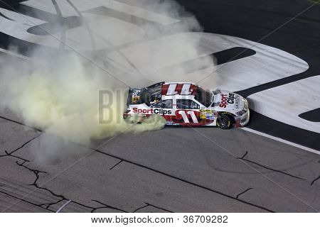 ATLANTA, GA - SEP 02, 2012:  Denny Hamlin (11) does his burnout after winning the AdvoCare 500 at the Atlanta Motor Speedway in Hampton, GA on Sep 2, 2012.