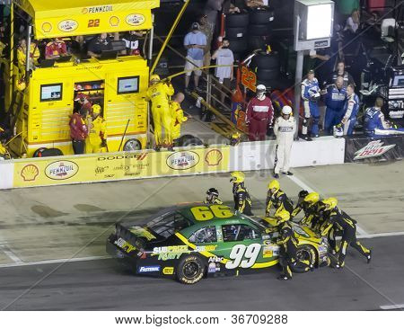 ATLANTA, GA - SEP 02, 2012:  Carl Edwards (99) is pushed back into the garage after his engine blows during the AdvoCare 500 at the Atlanta Motor Speedway in Hampton, GA  on Sep 2, 2012.