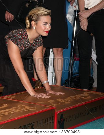 LOS ANGELES - SEP 11:  Demi Lovato at the FOX  X-Factor Judges Handprint Ceremony at Graumans Chinese Theater on September 11, 2012 in Los Angeles, CA
