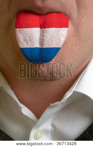 Man Tongue Painted In Netherlands Flag Symbolizing To Knowledge To Speak Foreign Language