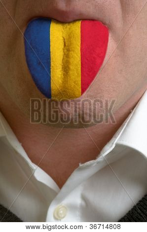 Man Tongue Painted In Romania Flag Symbolizing To Knowledge To Speak Foreign Language