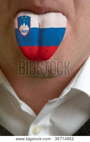 Man Tongue Painted In Slovenia Flag Symbolizing To Knowledge To Speak Foreign Language