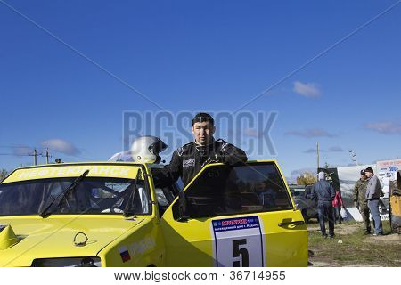 Pilot Nurali against his sports car