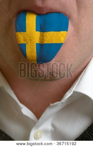 Man Tongue Painted In Sweden Flag Symbolizing To Knowledge To Speak Foreign Language