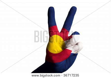 Colorado Us State Flag Two Finger Up Gesture For Victory And Winner Symbol Made With Hand