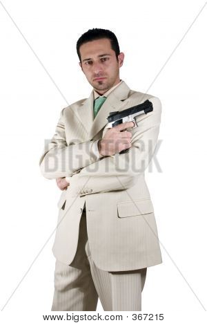 Mafia With Arms Crossed And A Gunon Hand