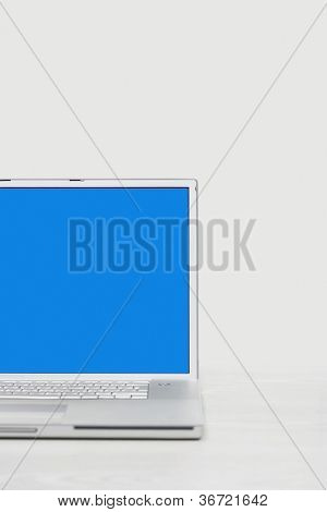 Open laptop with blue screen over white background