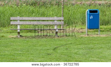 Park Bench And Blue Trash Can