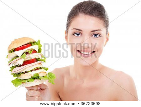 super huge burger or sandwich on a stick, presented by a young woman with a beautiful smile, on white background