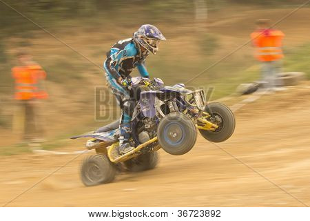 Dynamic Shot Of Rider In The Quad Jump