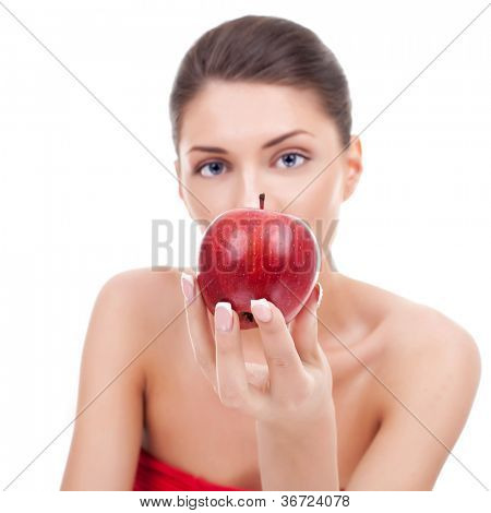 A shiny red apple presented by a beautiful young woman, on white background