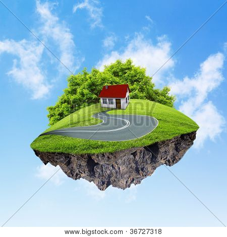 A piece of land in the air with house and tree.