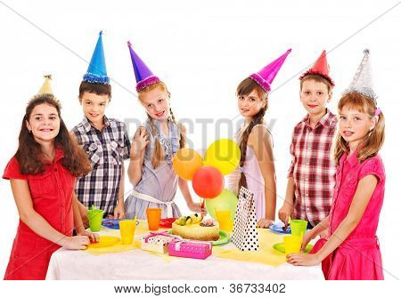 Birthday party of group teen with cake. Isolated.