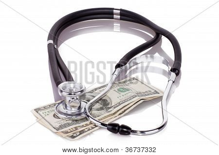 stethoscope on dollars