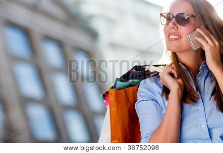 Beautiful woman shopping and talking on the phone