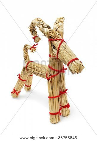Traditional Finnish christmas decoration straw billy goat made of straws and red yarn.