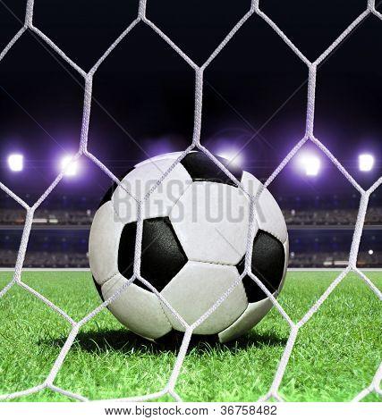 closeup soccer ball on green grass of stadium