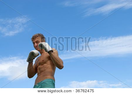 Young Guy In Boxing Gloves