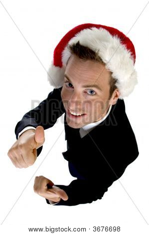 Caucasian Businessman With Cheerup And Santa Cap