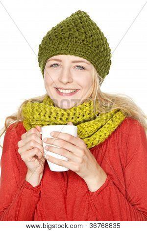 girl in winter drinking hot grog