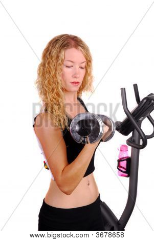 Attractive Woman Working Out With A Dumb Bell