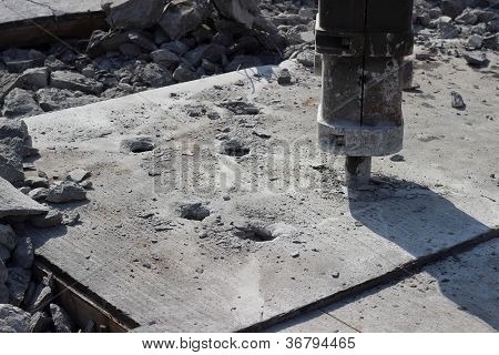 Jackhammer smashing concrete