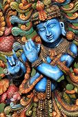 stock photo of krishna  - Colorful Wooden statue of Hindu God Lord Krishna - JPG