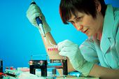stock photo of electrophoresis  - Girl experimenting with genetic material - JPG