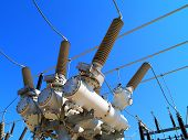 stock photo of transformer  - High voltage outdoor electrical substation with transformers - JPG