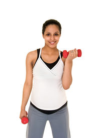 foto of pregnancy exercises  - Beautiful young Hispanic woman in a fitness workout using hand weights to keep herself physically fit during her pregnancy - JPG