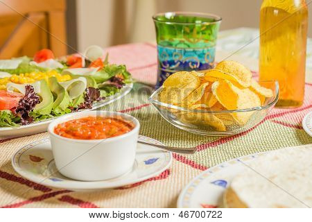 Traditional Mexican Food With A Bowl Of Nachos, Spicy Sauce, A Plate Of Tortillas And Fresh Salad