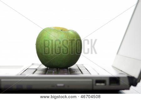 Green Apple On An Open Laptop Computer