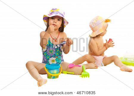 Girls Playing With Beach Toys