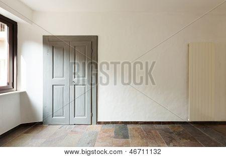closed door in a rustic house, stone floor