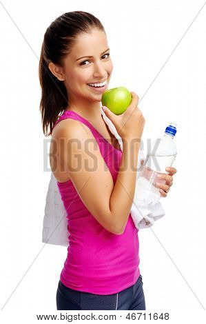 Healthy woman with water and apple diet smiling isolated on white