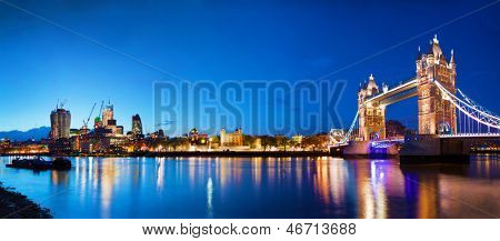 Tower Bridge in London, the UK at night. Panorama of the city centre